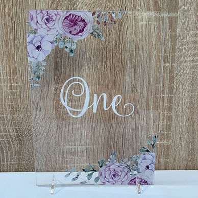 Lilac floral table numbers available for hire for weddings in Devon and Torbay.