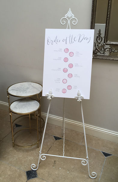 White ornate easel hired for a wedding at Rockbeare Manor, Exeter.