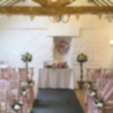 Ivory rose trees hired for a wedding ceremony at the Bickley Mill Inn, Devon.