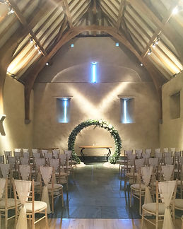 Chiffon chair drape hire for weddings in Devon and Torbay. Pictured at The Great Barn, Exeter.