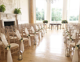Chair drapes and lanterns hired for a wedding at Rockbeare Manor, Devon.