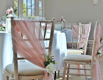 Chiffon chair drape hire for weddings in Devon and Torbay. Pictured at Rockbeare Manor.