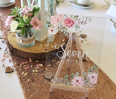 Pale pink floral table numbers available for hire for weddings in Devon and Torbay.