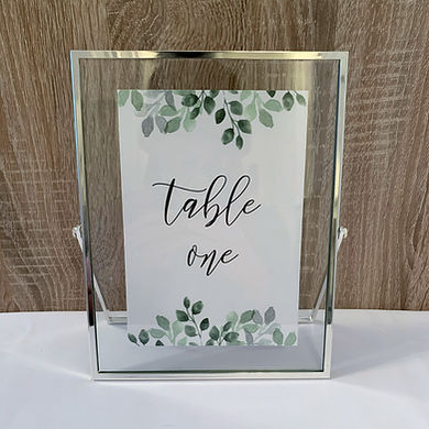 Silver floating frame table numbers available for hire for weddings in Devon.