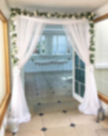 Doorway drapes at a wedding at Rockbeare Manor, Exeter.