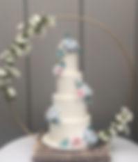 Gold hoop cake stand at a wedding at Trevenna Barns.