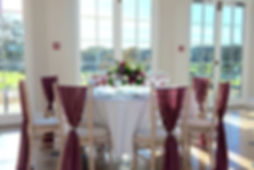 Elegant chiffon chair decor at Rockbeare Manor.