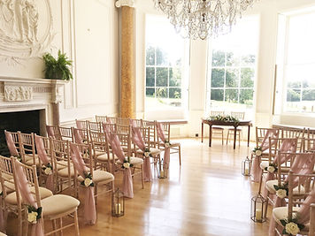 Chiffon chair drapes hired for a wedding at Rockbeare Manor.