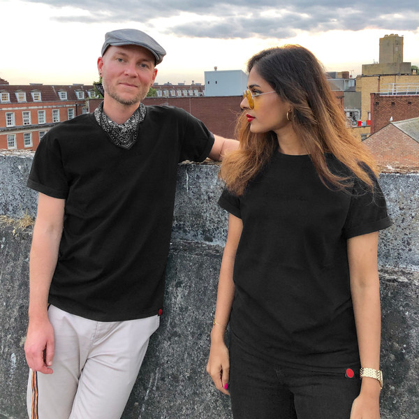 male and female wear black swearing is cool t-shirt on top of a car park in cardiff