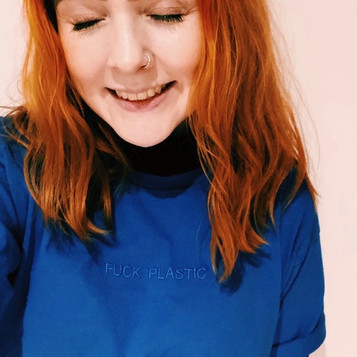ginger female smiles while wearing blue swearing is cool fuck plastic tshirt