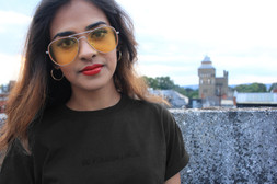 female wears black swearing is cool be fucking nice tshirt outside with cardiff castle in the background