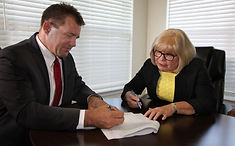 Cvercko signing documents.jpg