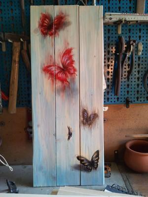 Watercolors butterfly on wood