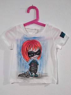 Ladruncola capelli arancio t-shirt dipin