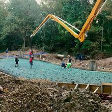FSI Crew Pouring Concrete Pad