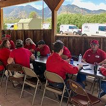 FSI Team Eating Lunch Together Outside at Base