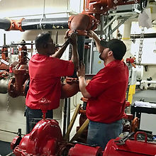 Teamwork Repairing a Facility Maintenance Issue Onsite