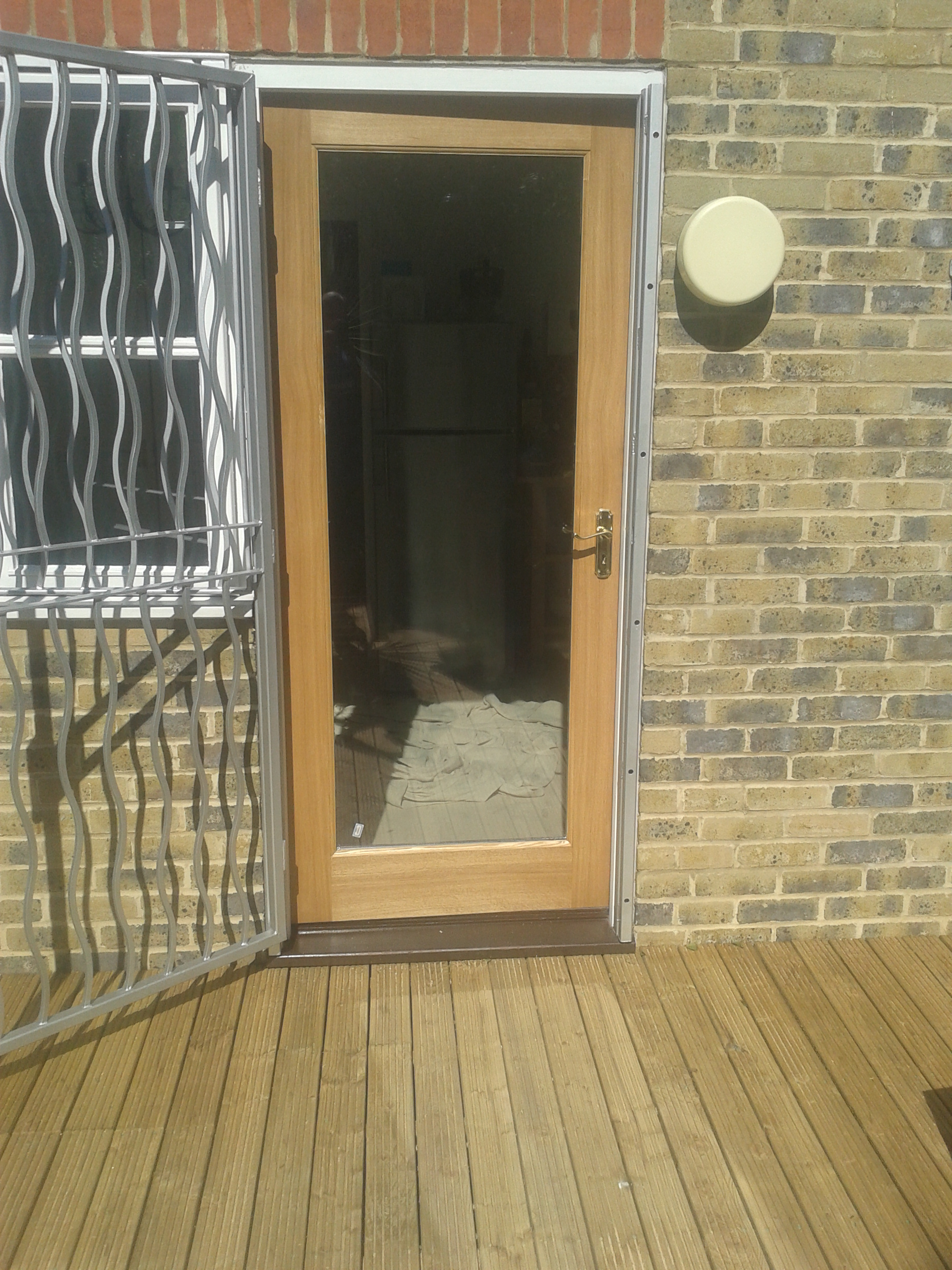 double glazed oak door with decking.jpg