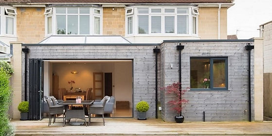 QN Design inspirational image of single storey flat roof extension with bi-folding door and open plan living space