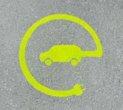 EV - electric vehicle charging station sign on asphalt.jpg _E_ sign on asphalt texture.jpg