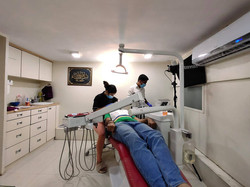 Dr. Sanah Working on a patient