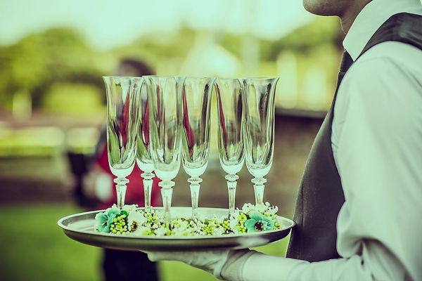 Waiter with Champagne Flutes_edited.jpg