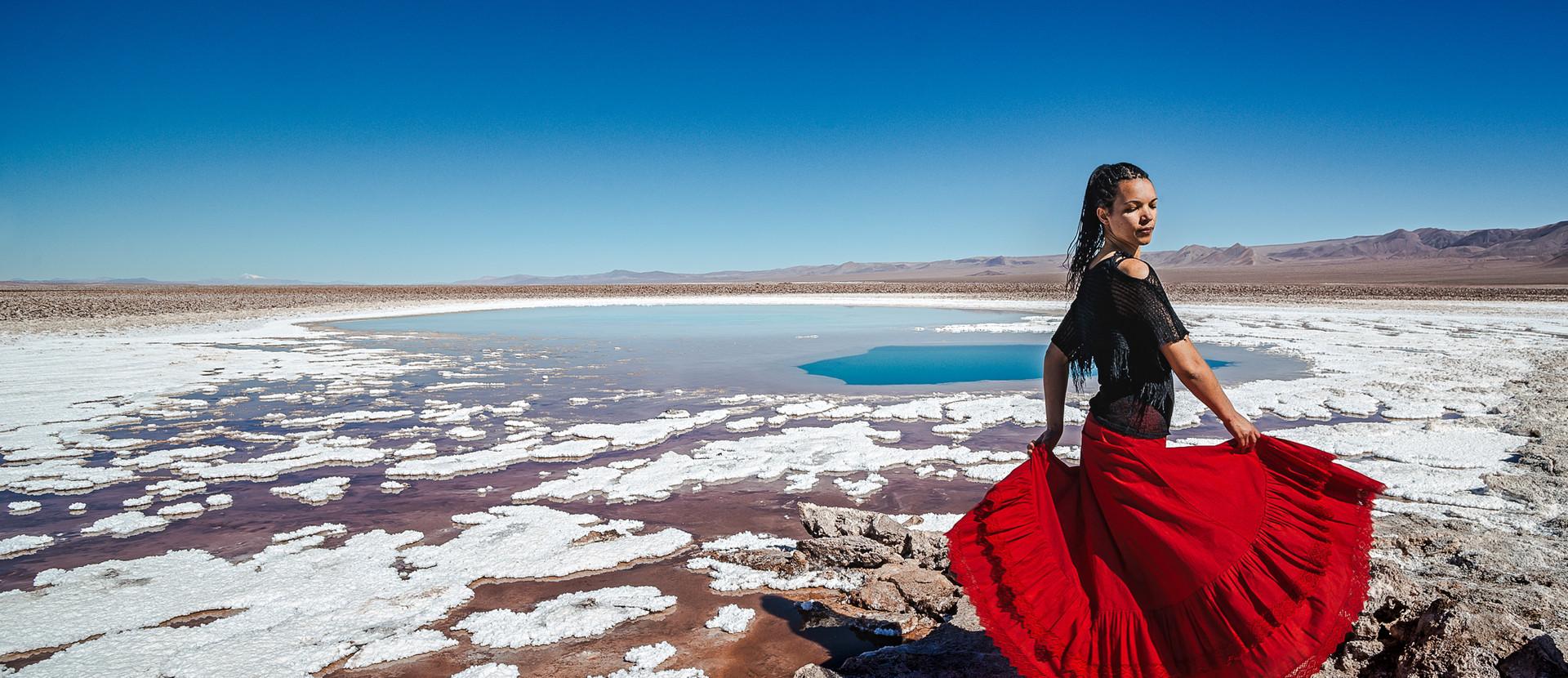 retrato portrait mujer bailando desierto de atacama desert woman dancing skirt dress blue skies lagunas escondidas baltinache lagoon blue salt flats salar white