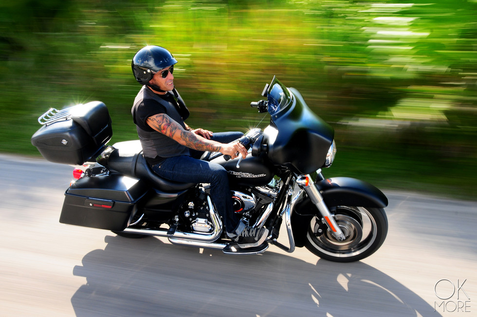 Comercial photography: motorcycle and rider action shot, biker on highway