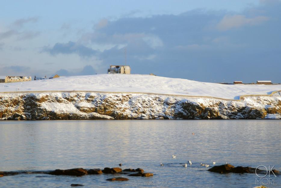 Travel photography destination Shetland island, Scotland town coast sea snow winter