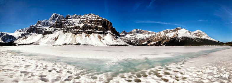 Travel photography, destination Canada Rockies frozen lake and mountains, ice highway banff to jasper