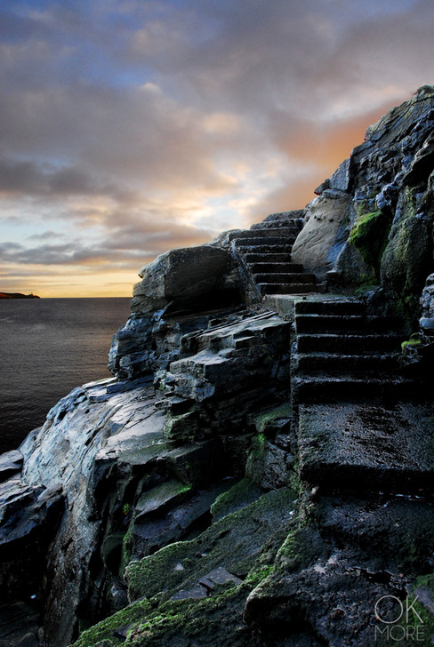 Travel photography destination Shetland island, Scotland, landscape, sunset, rocky steps by ocean cliffs lerwick