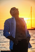 Musician photography. Portrait of Gio Ortega at sunset in Cozumel