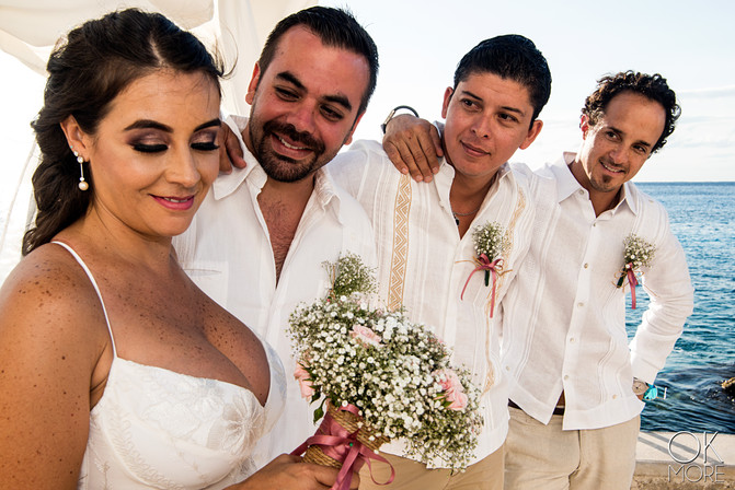 Wedding photography: wedding party portrait, ocean side and bouquet