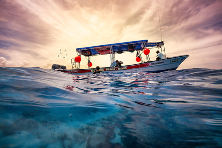 Commercial photography: Scuba Mau dive boat at caribbean sunset