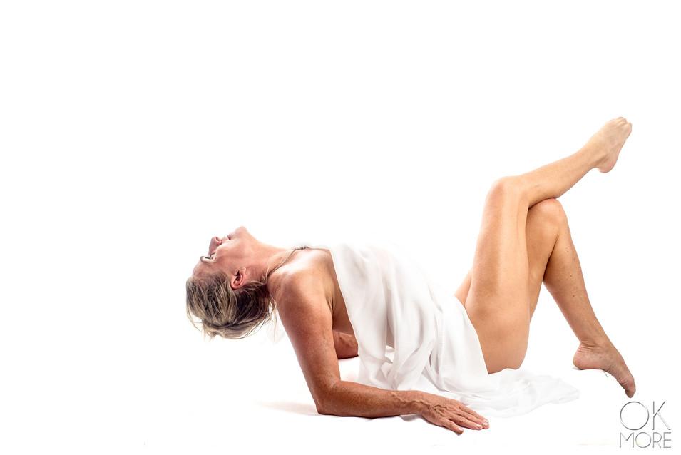 Fine art portrait, woman in white, boudoir
