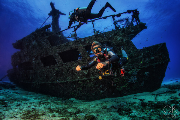 Commercial photography: underwater scuba diver woman wreck diving