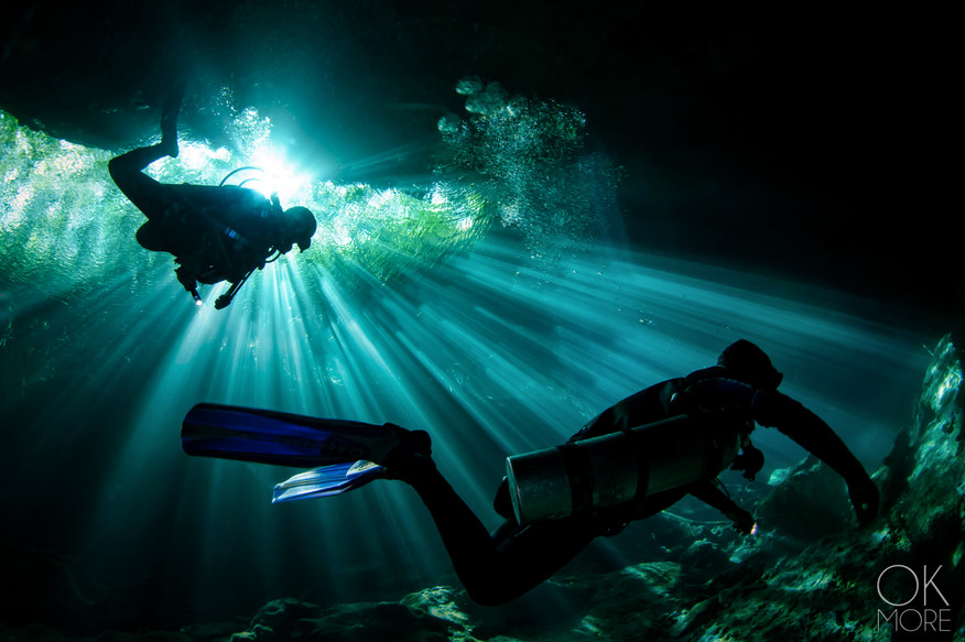 Commercial photography: underwater scuba divers at cenote, cave diving