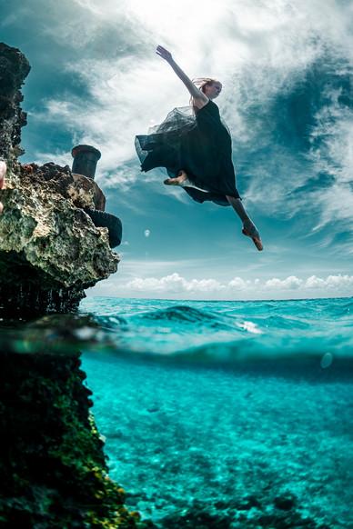 Dancer jumping in the ocean