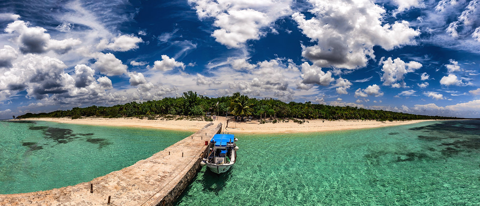 Commercial photography: blue project landscape of boat by pier at Cozumel island
