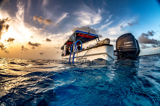 Commercial photography: blue project caribbean ocean, scuba boat at sunset, twilight