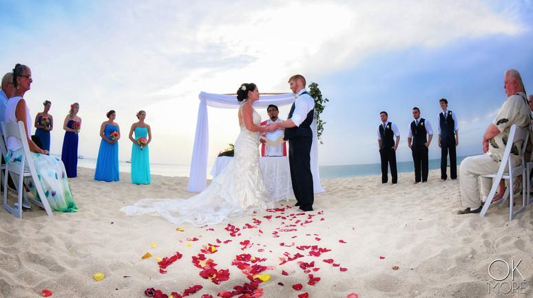 Wedding photography: ceremony, altar on the beach, caribbean ocean, rose petals