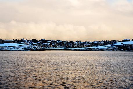 Travel photography destination Shetland island, Scotland, lerwick town at sunset winter snow