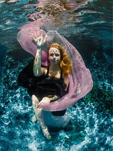 Dancer posing underwater