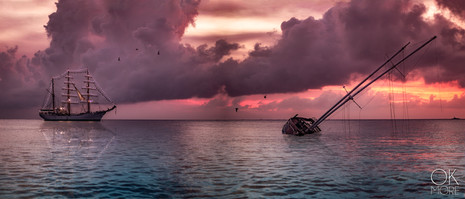 Landscape photography: A wrecked sailboat and a tall ship at sunset, cozumel, mexican caribbean