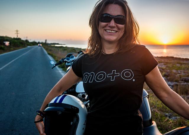 Portrait of a biker woman at sunset