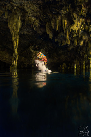 Portrait of a young woman in a cenote