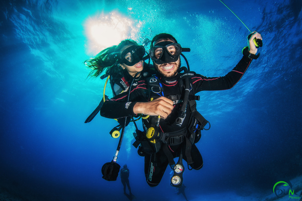 Commercial photography: underwater caribbean ocean, scuba divers safety stop