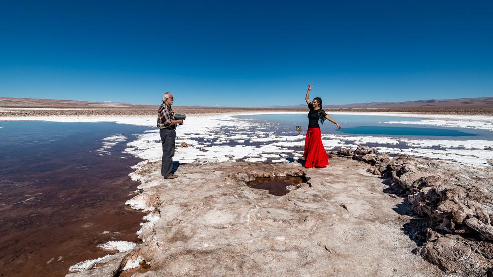 bts portrait dancing woman in salt lagoons of atacama desert, chile