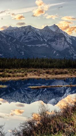 Travel photography, destination Canada Rockies, mountains at sunset, lake reflection