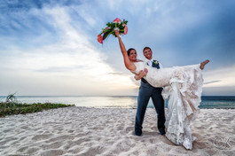 Wedding photography: couple portrait at sunset on the beach